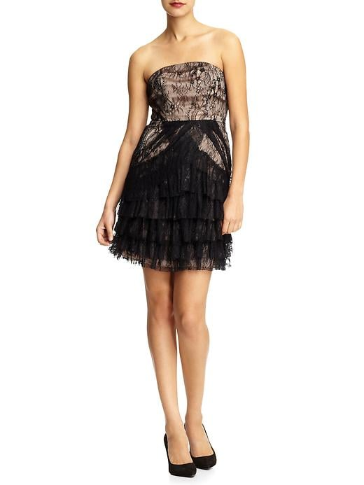 The pretty lace detailing makes this little strapless a standout.  Aryn K. Strapless Mini Dress (approx $60)