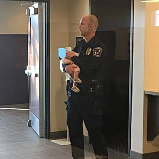 Police Officer Holds Baby For Mom at the Station