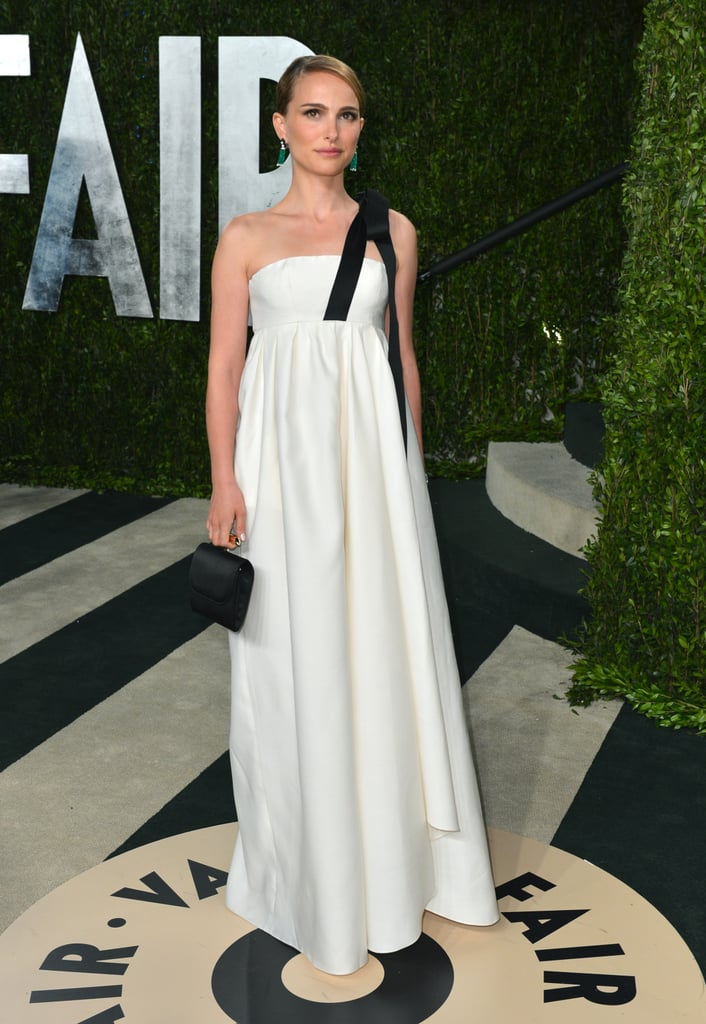 Dior also made an appearance at the Vanity Fair Oscars after-party. Natalie Portman donned a Dior white silk gown with black ribbon detail and a matching Dior clutch.