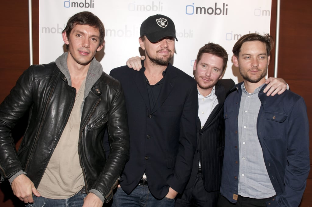 Leonardo DiCaprio had his best friends by his side last night for the Mobli 2.0 Launch Party in Austin. The city is currently hosting SXSW, and Leo's making the rounds with pals Lukas Haas, Kevin Connolly, and Tobey Maguire. In a rare move, Leo posed on the red carpet with his pals but was still practically unrecognizable with his trademark baseball cap pulled down low. Once inside Kenichi, Leo met up with his Victoria's Secret Angel girlfriend, Erin Heatherton. Kevin retweeted a picture of Leo's love Erin Heatherton from yesterday in Texas. Leo, meanwhile, posted on Mobli and shared an image of him and Tobey chilling in a booth. The night was part fun and part business for Leo, who's one of Mobli's investors.