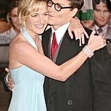 Kate Winslet got a sweet smooch from her Finding Neverland costar Johnny Depp in London in 2004.