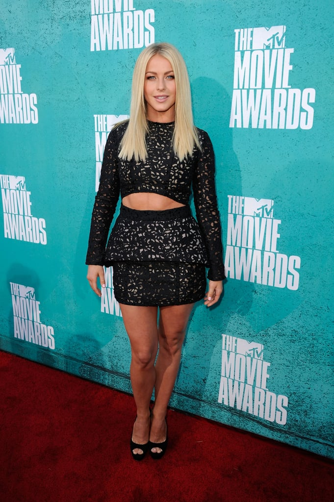 """Julianne Hough's abs peeked out of her dress at tonight's MTV Movie Awards in LA. She brought a young pal along for the award show and jokingly tweeted, """"Got an extra hot date with me tonight!"""" It's Julianne's second red carpet in a row after she also attended the Spike Guys Choice Awards yesterday. She presented with Malin Akerman at the show as the two ladies promoted Rock of Ages. The musical movie hits theaters on June 15 and features a singing and shirtless Tom Cruise as well as bikini-clad moments from Julianne.  Make sure to weigh in on all the MTV Movie Awards red-carpet fashion with Fab's polls."""