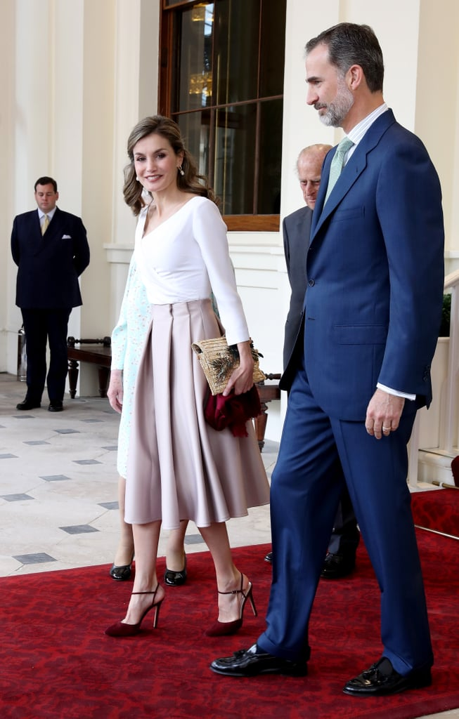 Queen Letizia Paired Her Topshop Skirt With a Straw Clutch