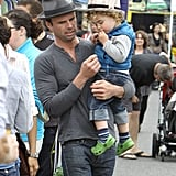 Justified star Walton Goggins carried his son Augustus during an Easter stroll through a farmers market in LA on Sunday.