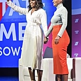 Michelle wearing a white fringe Rachel Comey wrap dress while talking to Tracee Ellis Ross at the United State of Women Summit in Los Angeles.