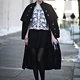 Coco Rocha turned the sidewalk into a runway with a cape draped over her shoulders.