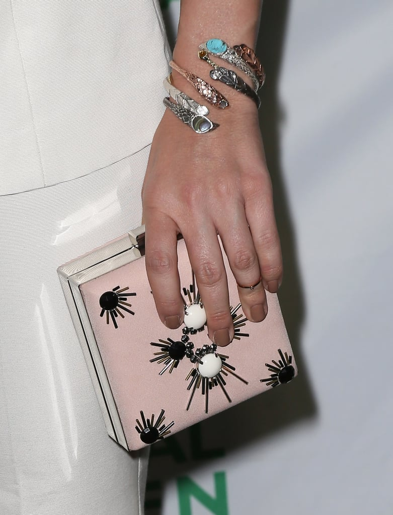 A closer look at Sophia's box clutch and silver wrap cuff.