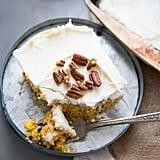 Pumpkin Roll Poke Cake