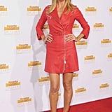 Heidi Klum wore a red coat on the carpet.