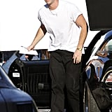 Liam Hemsworth hopped out of a car on the set of Empire State.