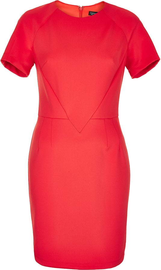 This Topshop Scuba seamed dress ($96) is a trendier update on the traditional sheath with a fiery hue and higher hemline.
