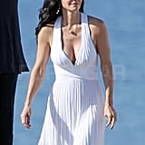 Courteney Cox wore a flowy white dress for the beach scene.
