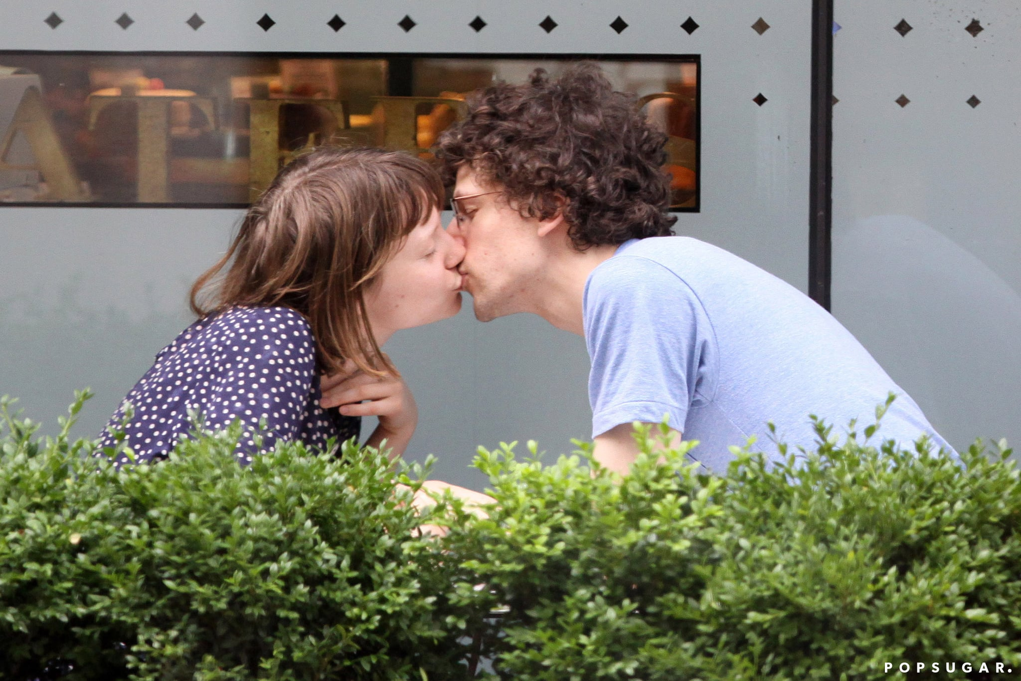 Jesse Eisenberg and Mia Wasikowska shared a kiss at an outdoor restaurant in Toronto.