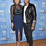 Chrissy showed off her black bandeau underneath her Self-Portrait dress, complementing John Legend's leather jacket.