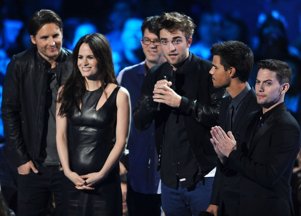 Robert Pattinson joined his Twilight buddies Taylor Lautner, Jackson Rathbone, Elizabeth Reaser, and Peter Facinelli at this evening's MTV VMAs in LA. Robert introduced an exclusive clip from Breaking Dawn Part 2 and also thanked the fans for their many years of support. They're gearing up for the release of the final film on Nov. 16. One of the series's stars was absent — Kristen Stewart's in Toronto premiering her On the Road. She stepped out with her other castmates Kirsten Dunst and Garrett Hedlund, looking gorgeous in a sheer Zuhair Murad gown.