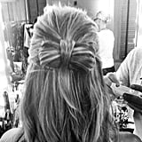 Heidi wore this half-up hairstyle tied with a bow for a taping of America's Got Talent.  Source: Instagram user heidiklum