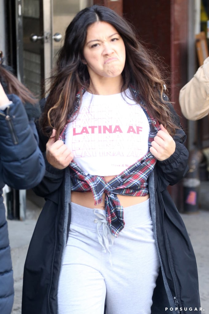 "Gina Rodriguez is currently filming the Netflix romantic comedy Someone Great, and on Monday, the 33-year-old got playful for the camera between scenes. While walking through the streets of NYC with costar DeWanda Wise, Gina spotted a photographer and took the opportunity to show off her T-shirt, which read ""Latina AF."" The Puerto Rican actress opened her plaid button-up to proudly reveal the cheeky top and share a laugh with DeWanda.       Related:                                                                                                           16 Gina Rodriguez Quotes That Will Inspire You to Follow Your Dreams               Gina is busy as f*ck too, thanks to a starring role in the sci-fi thriller Annihilation, a sweet red carpet date with boyfriend Joe LoCicero at the Oscars, and a new gig playing the role of Carmen Sandiego in an upcoming live-action film. All that, and she's still starring in the hit CW series Jane the Virgin. Keep reading to see Gina mugging for photographers on the set."