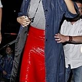 For an edgier Fourth of July outfit, look no further than Rihanna in a red patent leather skirt. Then tone it down with a gray tee, a denim jacket, and black pumps.