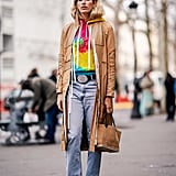 Style a tie-dye hoodie with a relaxed trench.