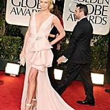 Charlize Theron wore a light pink Christian Dior dress at the 2012 Golden Globe Awards.