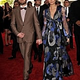 Caleb Followill of Kings of Leon holds hands with his expectant wife Lily Aldridge at the Grammys.
