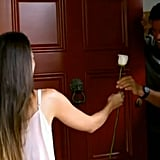 Heather surprises Sam at his door with the white rose.