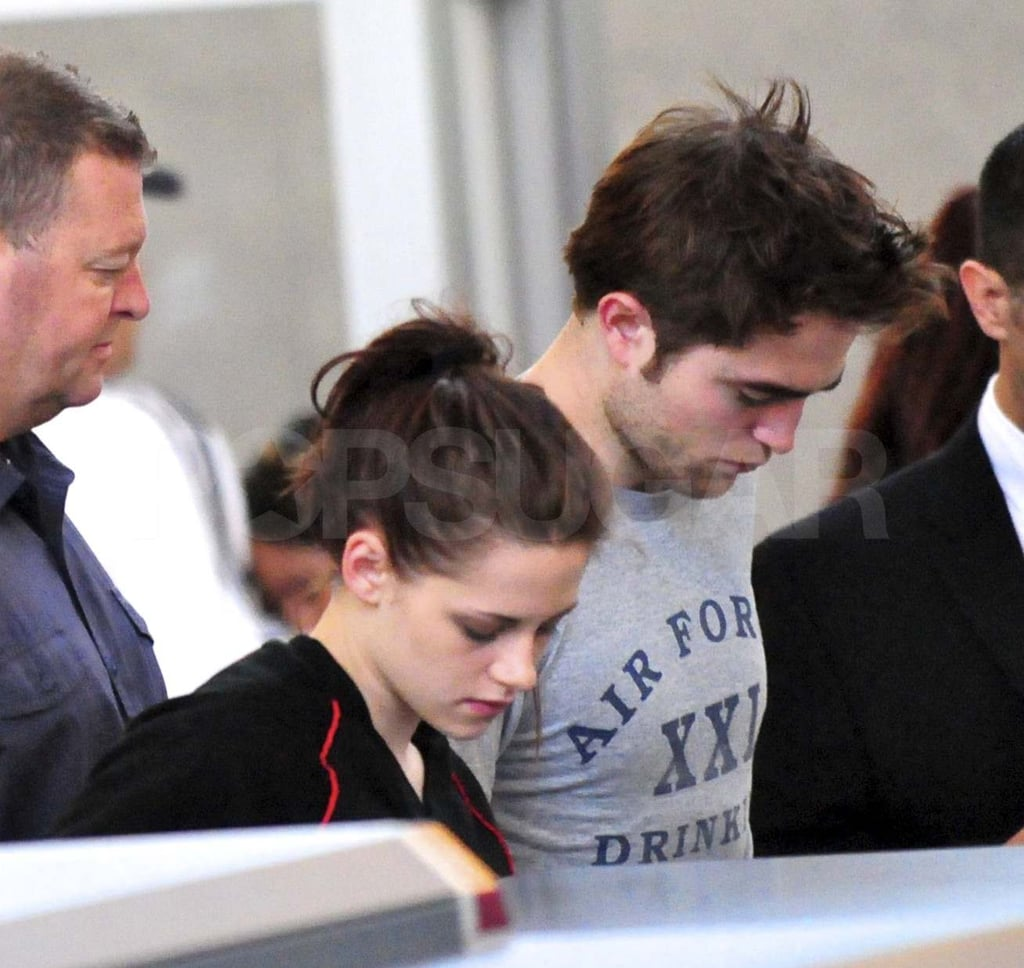 Robert Pattinson and Kristen Stewart were spotted going through security at LAX on Thursday. They headed out of town together to take care of reshoots for Breaking Dawn in the Caribbean after wrapping up work on the project in Vancouver last week. The on- and offscreen couple have already returned from the trip since Rob was seen catching a flight out of St. Thomas just yesterday. It was a big weekend for the star following the release of Water For Elephants on Friday. The movie didn't grab the number one spot at the box office, though fans of Rob and Reese Witherspoon still seemed excited about their big-screen effort.