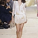 Kendall showed her girlie side at Diane von Furstenburg when she strutted down the catwalk in a flower- and butterfly-adorned white dress and matching hairpiece.