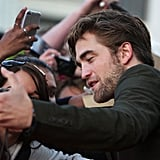 Robert Pattinson posed with fans in Sydney.