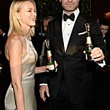 Naomi Watts and Liev Schreiber popped mini bottles of Moët & Chandon before the 2014 Globes.