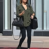 Lauren Conrad paired a silk army-green button-down with black pants and wedges for a day out in LA.