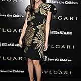At a Bvlgari event, Abigail rocked a strong-shoulder black cocktail dress and Brian Atwood Summer pumps.