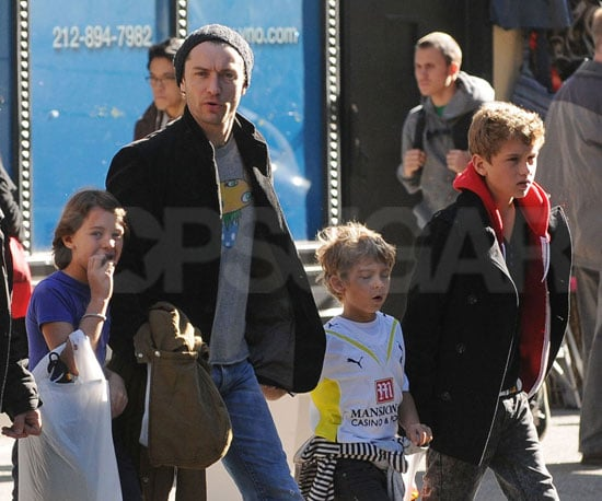 Slide Photo of Jude Law with kids Rafferty Iris and Rudy Halloween Shopping