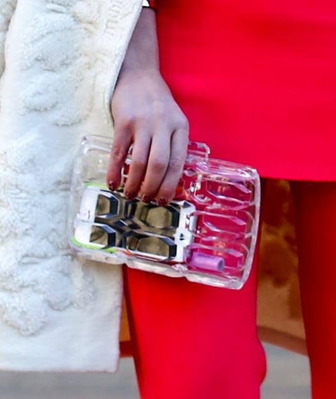 A clear clutch reveals all, in the chicest manner, of course.