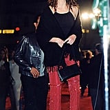 Julia's bedazzled red pants were balanced with a halter tank, tasseled shawl, and strappy sandals at the Erin Brockovich premiere in 2000.