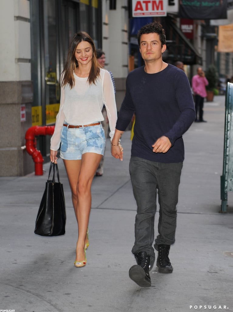 """Miranda Kerr made the NYC sidewalks her catwalk yesterday while out on a stroll with her husband, Orlando Bloom. The couple looked adorable together and held hands on their way back to a hotel. The happy duo are in the Big Apple with their son, Flynn Bloom, who's been able to enjoy outings with Miranda this week. She arrived in the city a few days ago to meet up with her boys and is having a great time —Miranda posted a photo on Instagram with the caption, """"I love NYC!""""  Miranda's able to have fun with family but is still tending to her Kora Organics blog. In a recent post, Miranda wrote about her mom's cookbook. She wrote, """"I was blessed to have a mum who would always cook homemade, healthy, nutritious, yet really tasty meals for us. . . what would always make these meals even more special is that she would fill them with love — the key ingredient."""""""