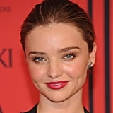 A fresh-faced Miranda Kerr chose a rosy-pink lipstick hue, which only further enhanced her cool-toned eyes.
