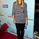 Lauren looked casual chic in a sweater and leggings at Disney on Ice in 2010. Lesson from Lauren: stay toasty and trendy with a slouchy beanie.