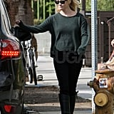 Reese Witherspoon in a green sweater.