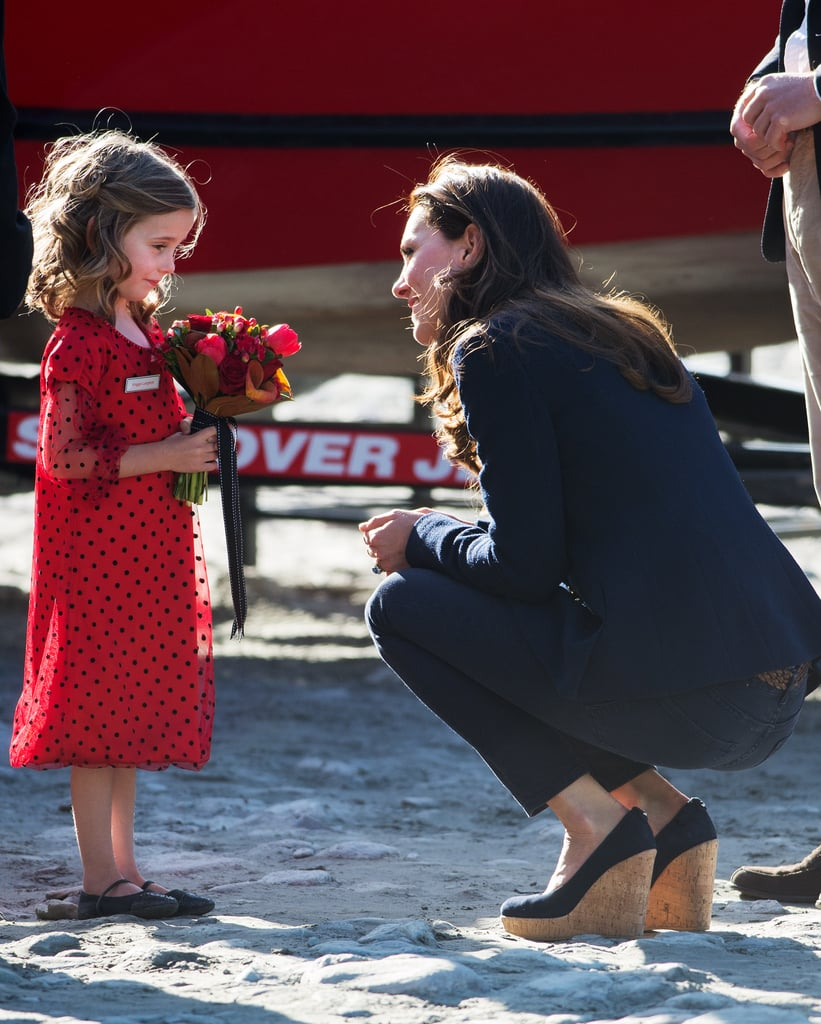 Kate bent down to speak to this little girl as she arrived at an event during her tour of New Zealand in April 2014.