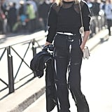 Anja Rubik offset a sheer-sleeved sweatshirt with high-waist trousers for a polished, albeit sporty, style.