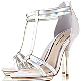Turn up the glamour of any dress with these silver metallic heels peeking out from underneath.  Topshop Barely There Sandals ($156)