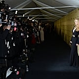 Kate Hudson struck a pose for a crew of photographers outside The Weinstein Company's Globes party.