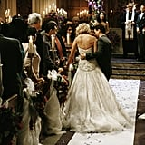 Izzie has to get a helping hand from George (T.R. Knight) as she makes her way down the aisle.