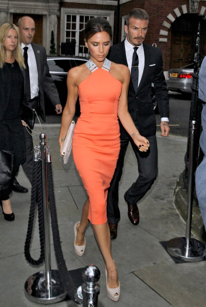 Victoria Beckham wore a dress of her own design to attend a party in London this evening with her husband, David Beckham, and some friends. The bright dress has also been seen on some of Posh's famous fans, like Jennifer Lopez. David and Victoria are enjoying British traditions, as well as catching up with old pals, during their stay in their native country. The Beckhams went to Wimbledon yesterday, when they caught up with Kate and Pippa Middleton, and cheered on Andy Murray during the tennis tournament's finals.  Victoria was last in the UK less than two weeks ago to announce the opening of a Spice Girls musical, Viva Forever!, and after a quick stop in LA, returned back to link up with David. The Beckhams are now looking forward to the start of the London Olympics. David unfortunately didn't make his country's Olympics team, but hopefully he'll find some consolation in having been nominated to play on the MLS All-Star First squad back in the US. First up, though, will be the most special celebration of all —their daughter, Harper Beckham, turns 1 tomorrow.