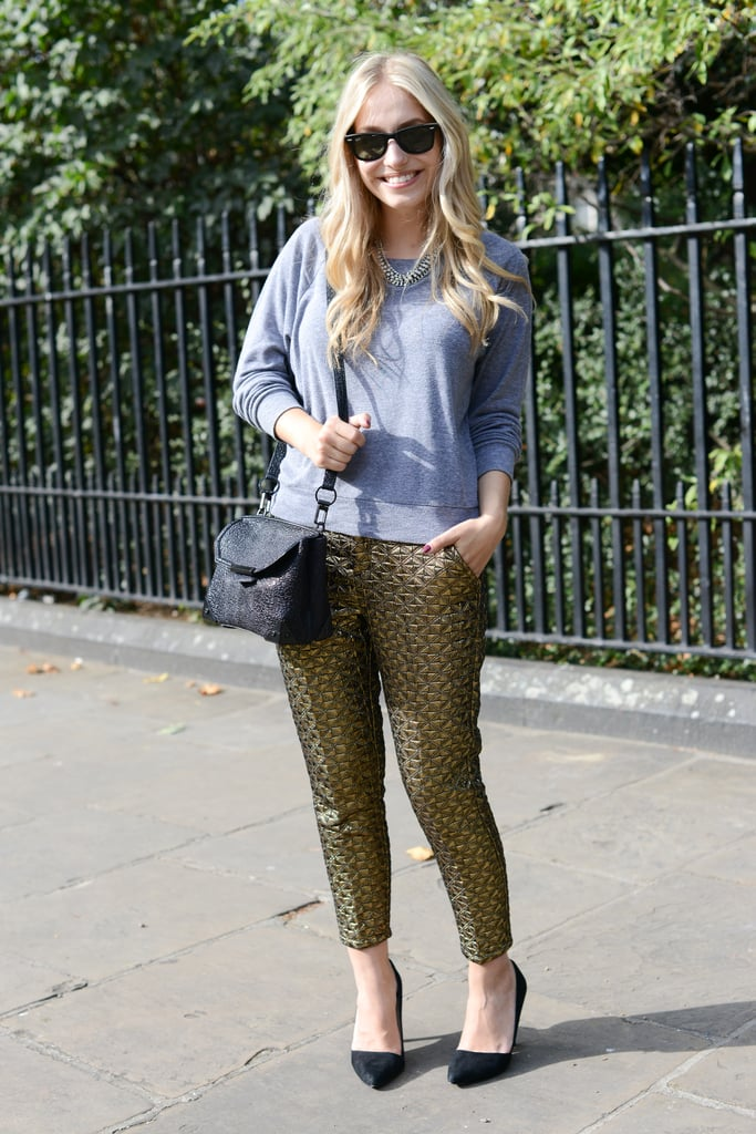 To pare down her look, she juxtaposed printed trousers against a low-key grey sweatshirt.