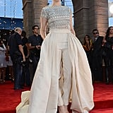 Holland Roden was a vision of sophistication in an embellished Naeem Khan jumpsuit featuring a full skirt with a train.