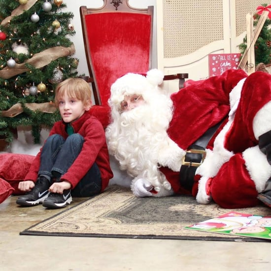 Sensory-Friendly Santa Takes Photo on the Ground With Child