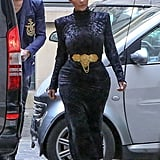 While Kim tends to go for skin-baring looks, she covered up in a velvet turtleneck dress while arriving at the Balmain office in Paris in 2014.