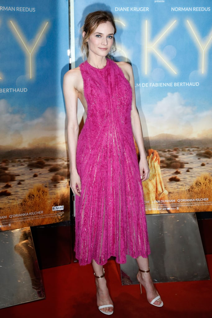 "Diane Kruger is the master of picking the perfect dress for any given red carpet. For Tuesday's Paris premiere of her new film Sky, Diane was clearly thinking of Spring when she selected a pink, textured gown from Hugo Boss. Diane had help with her look from makeup artist, Bedot Regine, and hair stylist, Perrine Rougemont.  Sharing the dress credit online, Hugo Boss described Diane's selection as ""a distressed chiffon dress, direct from the runway."" The dress was, in fact, fresh from the brand's Autumn 2016 show, which took place during New York Fashion Week in February. And there's a sweet connection, too: Hugo Boss's designer, Jason Wu, is one of Diane's dearest friends. Even though fashion and film were the main events, Diane's mind was almost elsewhere. On her way to the screening, she posted a photo on Instagram of herself with director Fabienne Berthaud. She wrote, ""On our way...Paris Premiere...missing my co-stars @bigbaldhead @lenadunham @vancityjax,"" who are, of course, Norman Reedus, Lena Dunham, and Joshua Jackson, her real-life boyfriend who also has a role in the film."
